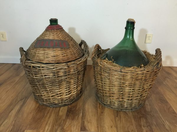 SOLD – Italian Demijohns in Baskets – A Pair