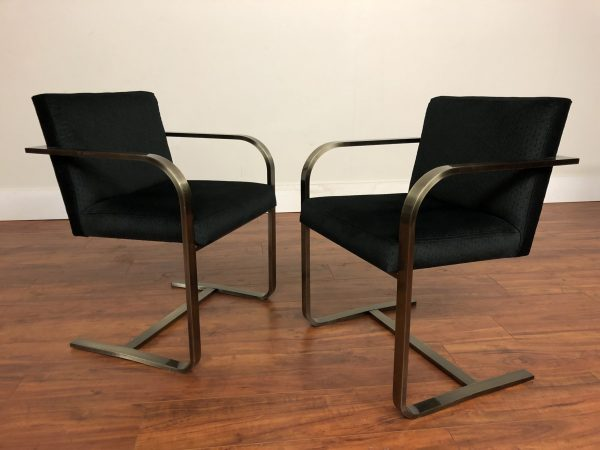 Pair of Black Cantilevered Chairs – $795